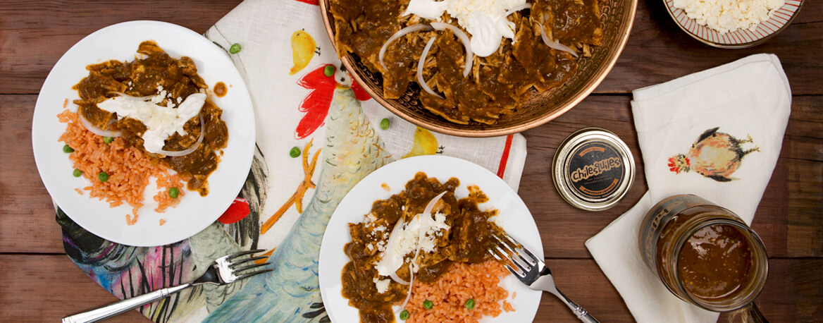 CHILAQUILES WITH PORK LEG IN HOMEMADE CHIPOTLE SAUCE